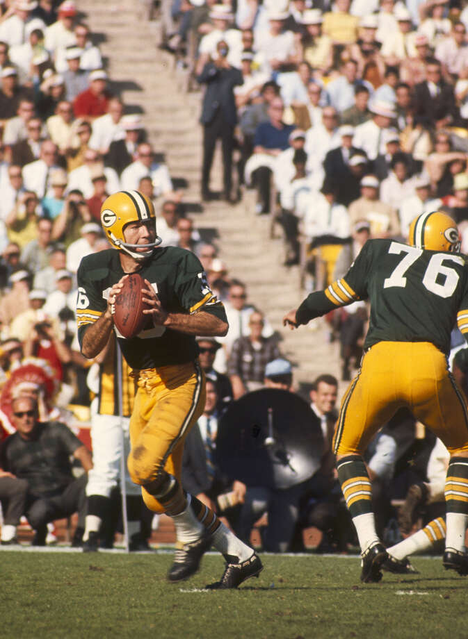 Green Bay quarterback Bart Starr (15) drops back to pass during Super 