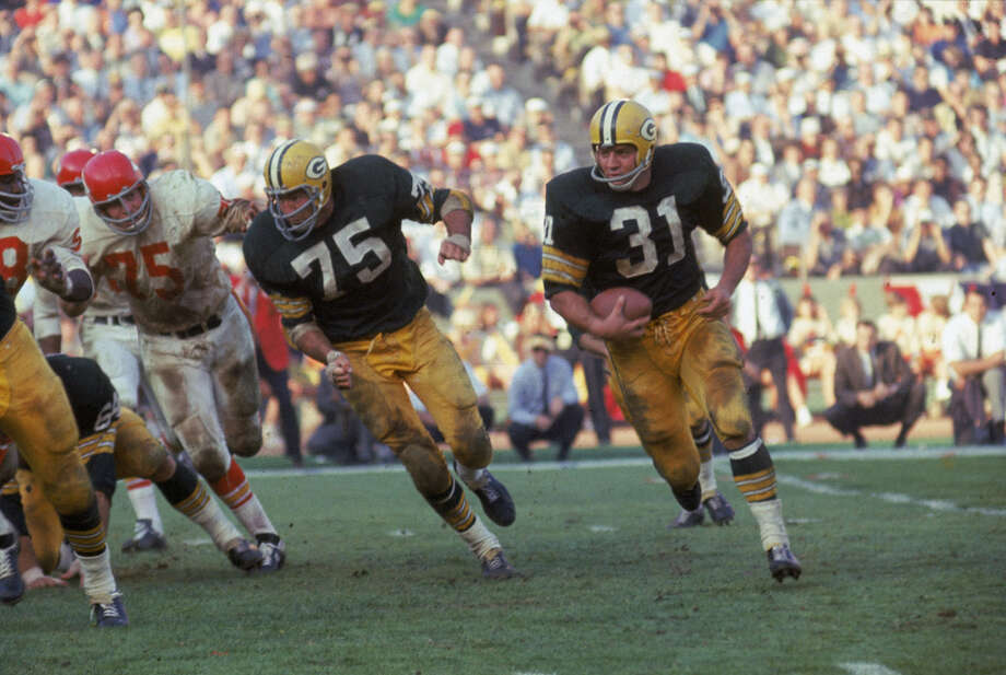 Green Bay's Jim Taylor (right) runs with the ball as teammate Forrest Gregg blocks for him during Super Bowl I against Kansas City in Los Angeles on Jan. 15, 1967. Photo: Robert Riger, Getty Images / 2006 Getty Images