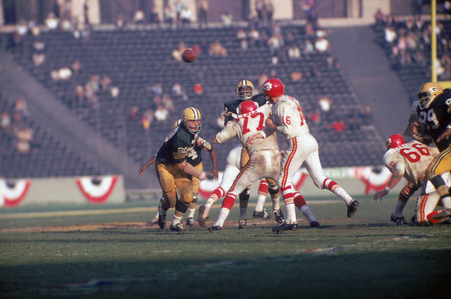 Kansas City quarterback Len Dawson (center, 16 in white) throws the ball as Green Bay's Lee Roy Coffey (left, 80) closes in during Super Bowl I in Los Angeles on Jan. 15, 1967. Photo: Robert Riger, Getty Images / 2006 Getty Images