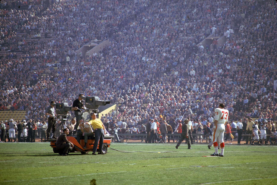 Kansas City's Dave Hill (right) is filmed by a CBS Television camera crew at Super Bowl I between the Chiefs and the Green Bay Packers at the Los Angeles Memorial Coliseum in Los Angeles on Jan. 15, 1967. Photo: Robert Riger, Getty Images / 2006 Getty Images