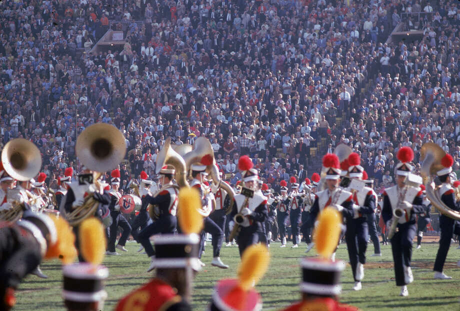 Members of the University of Arizona marching band perform on the field during the halftime show at Super Bowl I between the Kansas City Chiefs and the Green Bay Packers at the Los Angeles Memorial Coliseum in Los Angeles on Jan. 15, 1967. The University of Michigan marching band also performed at the halftime show. Photo: Robert Riger, Getty Images / 2006 Getty Images