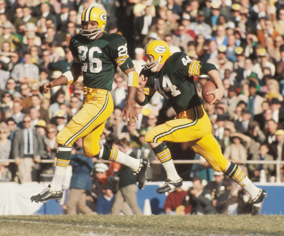Green Bay kick returner Donny Anderson (44) looks for more running room as teammate Herb Adderly (26) sets up for his next block during Super Bowl I on Jan. 15, 1967, against the Kansas City Chiefs at the Los Angeles Memorial Coliseum in Los Angeles. Photo: Kidwiler Collection, Getty Images / 1967 Diamond Images