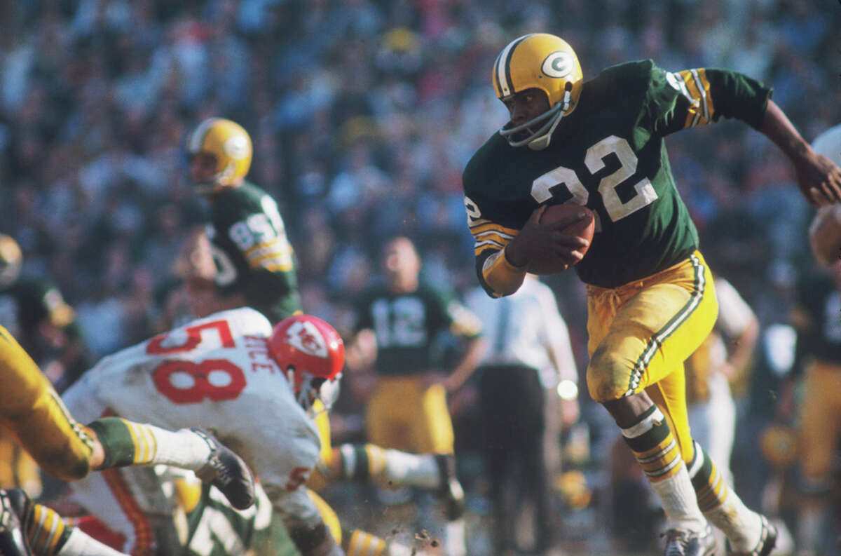 Green Bay's Elijah Pitts (22) runs with the ball against the Kansas City Chiefs' defense during Super Bowl I at Memorial Coliseum on Jan. 15, 1967, in Los Angeles.