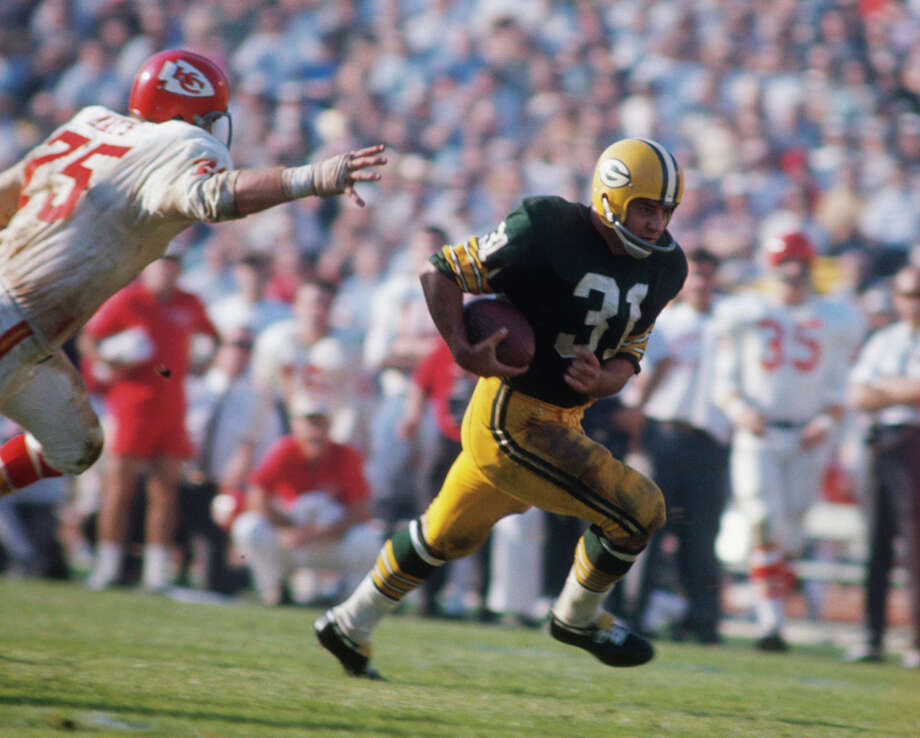 Jim Taylor of the Green Bay Packers runs during Super Bowl I against the Kansas City Chiefs at Memorial Coliseum on Jan. 15, 1967, in Los Angeles.  The Packers defeated the Chiefs 35-10. Photo: Focus On Sport, Getty Images / 1967 Focus On Sport