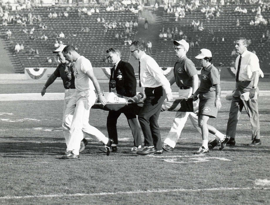 "Kansas City's Fred ""The Hammer"" Williamson (24) is taken off the field on a stretcher during Super Bowl I against Green Bay at Los Angeles Memorial Coliseum in Los Angeles  on Jan. 15, 1967. Photo: Robert Riger, Getty Images / 1967 Robert Riger"
