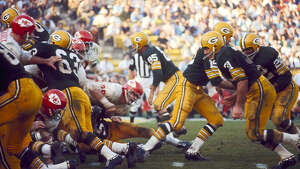 Green Bay Packers Hall of Fame quarterback Bart Starr (15) hands off to running back Elijah Pitts (22) during Super Bowl I, a 35-10 victory over the Kansas City Chiefs on January 15, 1967, at the Los Angeles Memorial Coliseum in Los Angeles, California.
