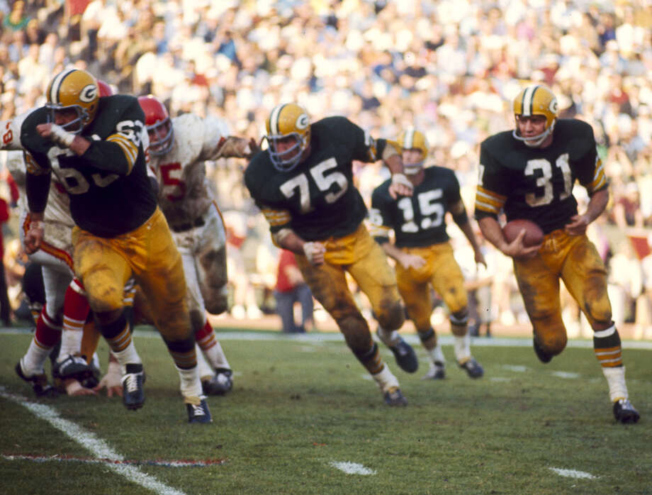 "Green Bay running back Jim Taylor carries the ball in the famed ""Green Bay sweep"" against the Kansas City Chiefs in the Packers' 35-10 win in Super Bowl I played on Jan. 15, 1967, at the Los Angeles Memorial Coliseum in Los Angeles. Photo: James Flores, Getty Images / Getty Images North America"
