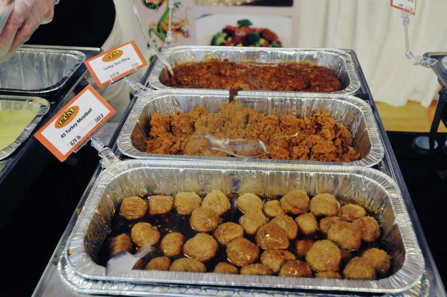 Turkey meatballs and other products made with turkey on display at the J.T.M. Food Group display booth at the New York School Nutrition Association Regional Industry Seminar on Tuesday, Jan. 14, 2014 in Albany, NY.  (Paul Buckowski / Times Union) Photo: Paul Buckowski / 00025358A