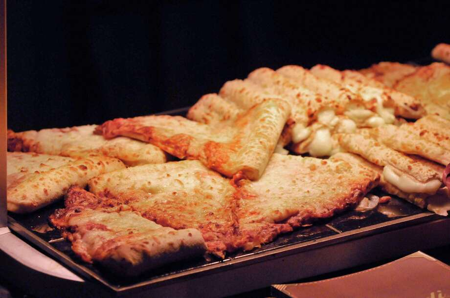 Pizza under a heat lamp on display at the New York School Nutrition Association Regional Industry Seminar on Tuesday, Jan. 14, 2014 in Albany, NY.  (Paul Buckowski / Times Union) Photo: Paul Buckowski / 00025358A