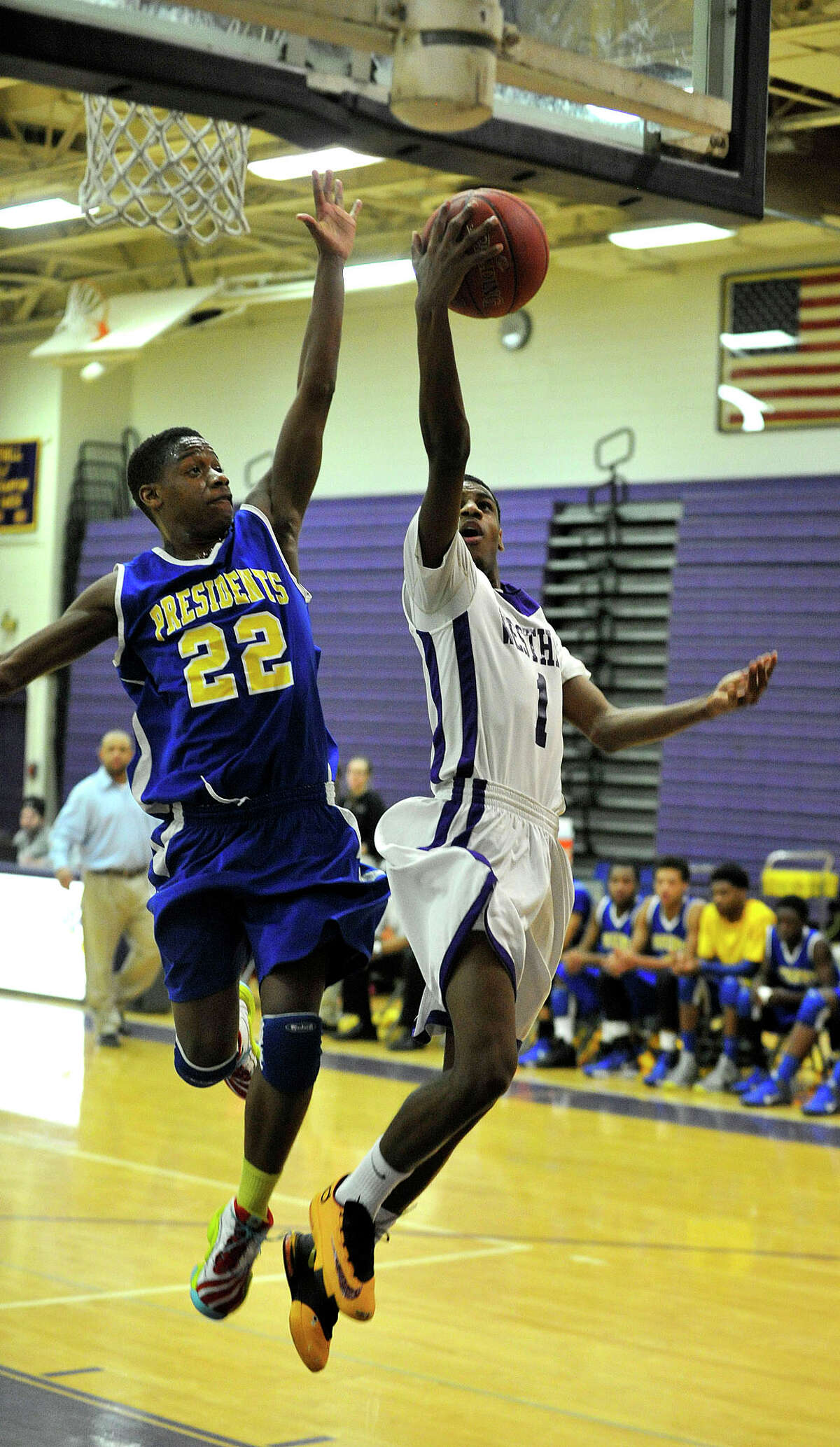 Westhill's Jeremiah Livingston attempts a layup while under pressure from Harding's Malcolm Simmons during their basketball game at Westhill High School in Stamford, Conn., on Tuesday, Jan. 14, 2014. Westhill won, 67-50.