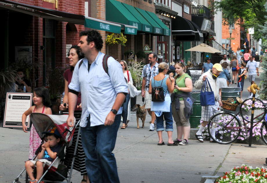 A crowd enjoying the streetscape on Broadway, Saratoga Springs, in August.
