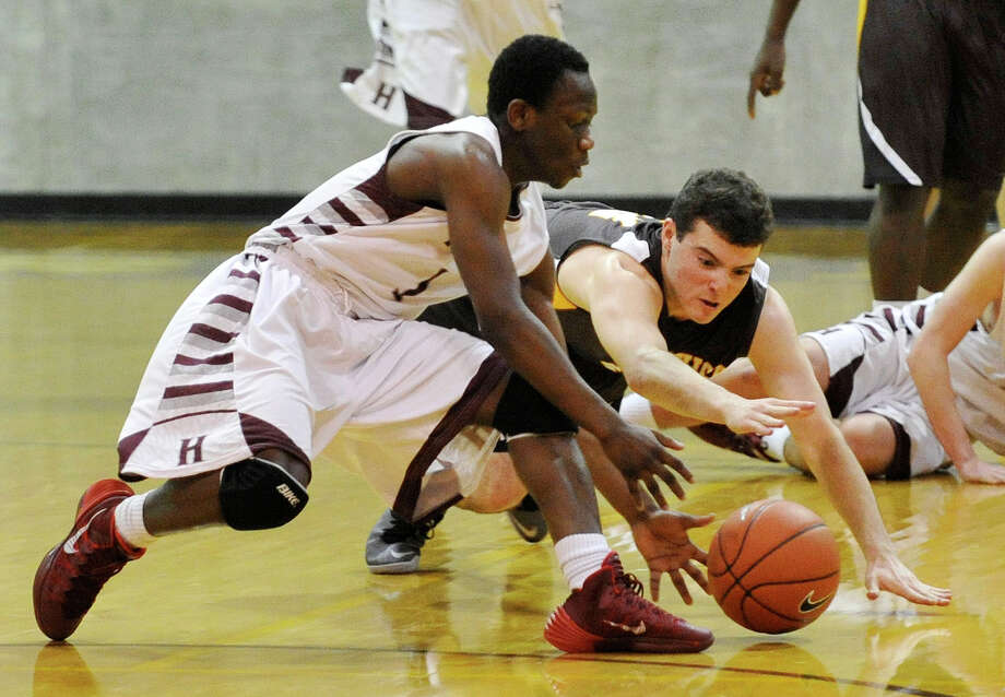Brunswick's Billy O'Malley and Hopkins' Kofi Adjepong scramble for the loose ball during their basketball game at Brunswick School's Simpson Athletic Center in Greenwich, Conn., on Monday, Jan. 13, 2014. Hopkins won, 60-58. Photo: Jason Rearick / Stamford Advocate