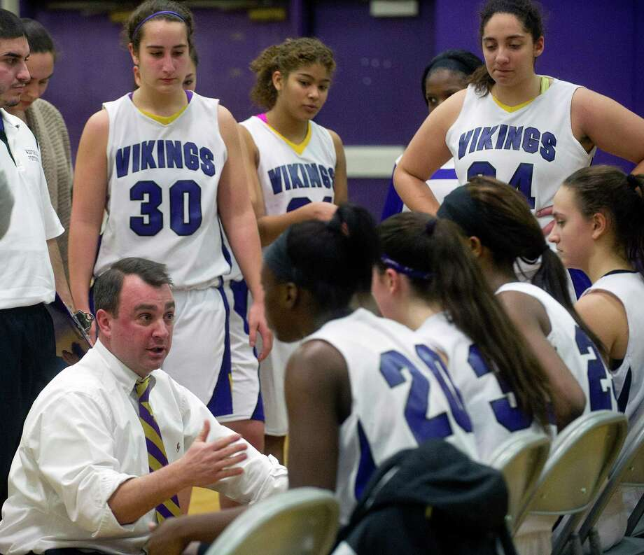 Westhill coach Mike King talks to his team during Friday's girls basketball game at Westhill High School in Stamford, Conn., on January 10, 2014. Photo: Lindsay Perry / Stamford Advocate