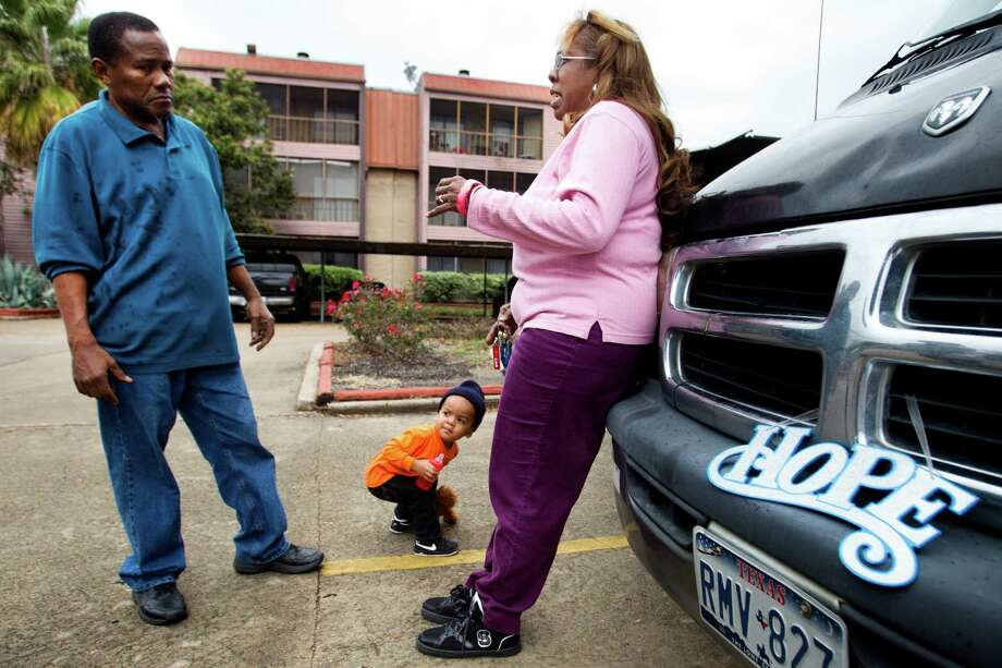 Jaime Rivera, left, and Sara Cruz, 60, stand outside her apartment complex Friday, Jan. 10, 2014, in southwest Houston. Cruz said she feels safe in her apartment, but would like to have more police patrolling the area. ( Brett Coomer / Houston Chronicle ) Photo: Brett Coomer, Staff / © 2014 Houston Chronicle