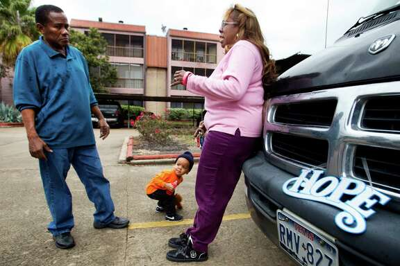 Jaime Rivera, left, and Sara Cruz, 60, stand outside her apartment complex Friday, Jan. 10, 2014, in southwest Houston. Cruz said she feels safe in her apartment, but would like to have more police patrolling the area. ( Brett Coomer / Houston Chronicle )