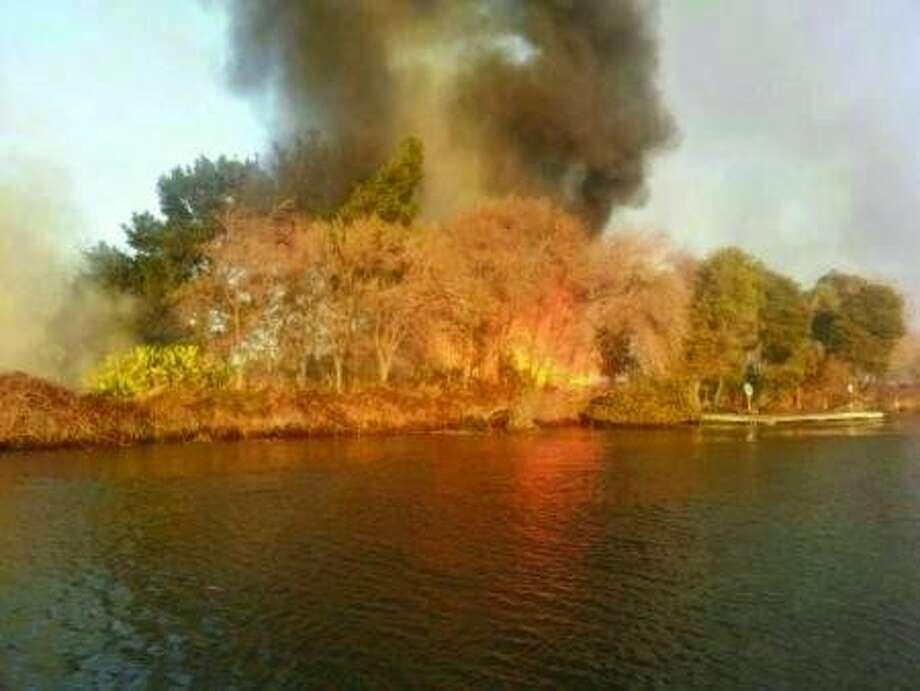A brush fire burned on Kimball Island for several hours Tuesday, Jan. 14, 2014.Ê Photo: Courtesy Of Coast Guard Station
