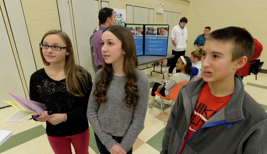 Students Madison LaVoy, left, Lauren Nicoll, center, and Anthony DeGiorgio, right, speak to the Times Union about their high school interviews during High School Fair Day at Gardener-Dickinson Tuesday afternoon, Jan. 14, 2014, in Wynantskill, N.Y. Wynantskill, N.Y. Wynantskill doesn?t have a high school of its own, so 8th grade students are offered a choice in which high school to attend come September. (Skip Dickstein / Times Union) Photo: SKIP DICKSTEIN / 0025311A