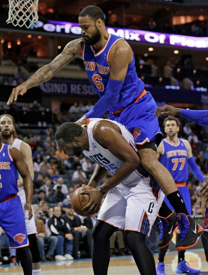 New York Knicks' Tyson Chandler, top, fouls Charlotte Bobcats' Al Jefferson during the first half of an NBA basketball game in Charlotte, N.C., Tuesday, Jan. 14, 2014. (AP Photo/Chuck Burton) ORG XMIT: NCCB102 Photo: Chuck Burton / AP