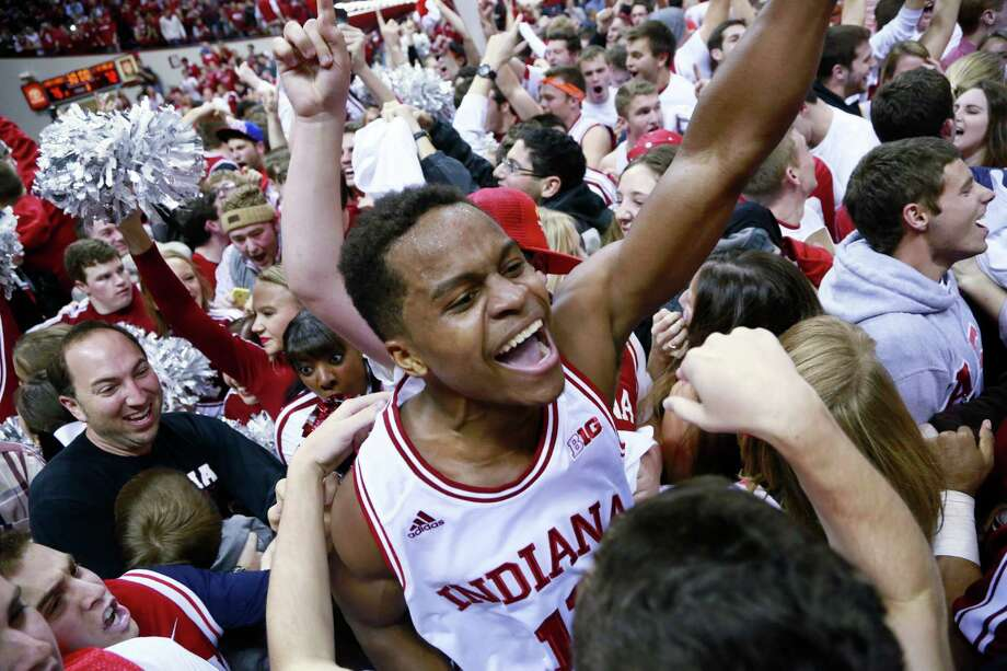 "Indiana guard Kevin ""Yogi"" Ferrell, center, celebrates with fans on the basketball floor after an NCAA basketball game against Wisconsin in Bloomington, Ind., Tuesday, Jan. 14, 2014. Indiana won 75-72. (AP Photo/R Brent Smith) ORG XMIT: INBS104 Photo: R Brent Smith / FR171017 AP"