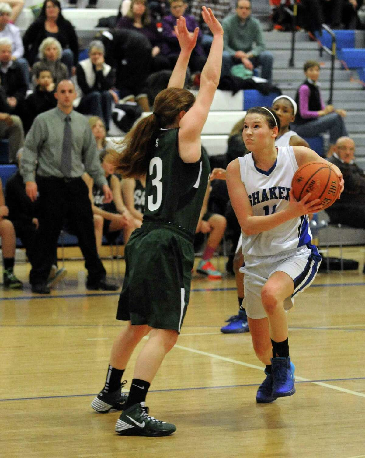 Shaker's Jenni Barra drives to the basket during their girl's high school basketball game against Shen on Tuesday Jan. 14, 2014 in Colonie, N.Y. (Michael P. Farrell/Times Union)