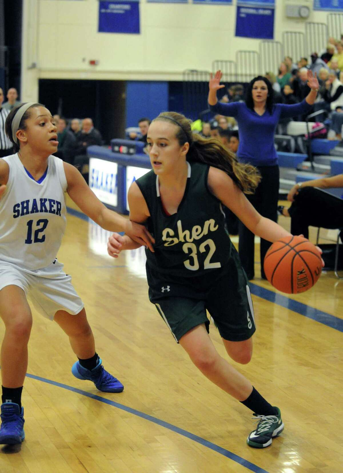 Shen's Carly Boland brings the ball up court guarded by Shaker's Rowland Merrick during their girl's high school basketball game on Tuesday Jan. 14, 2014 in Colonie, N.Y. (Michael P. Farrell/Times Union)