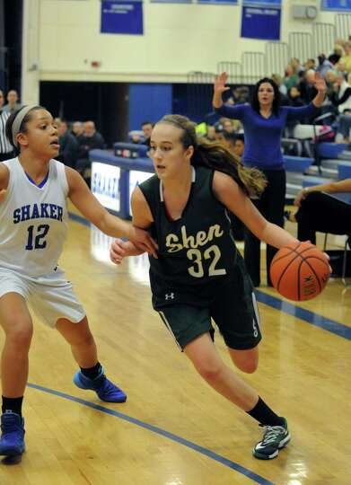 Shen's Carly Boland brings the ball up court guarded by Shaker's Rowland Merrick during their girl's