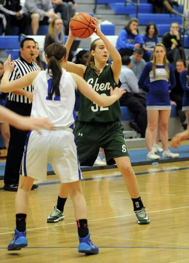 Shen's Carly Boland looks for an open teammate during their girl's high school basketball game again