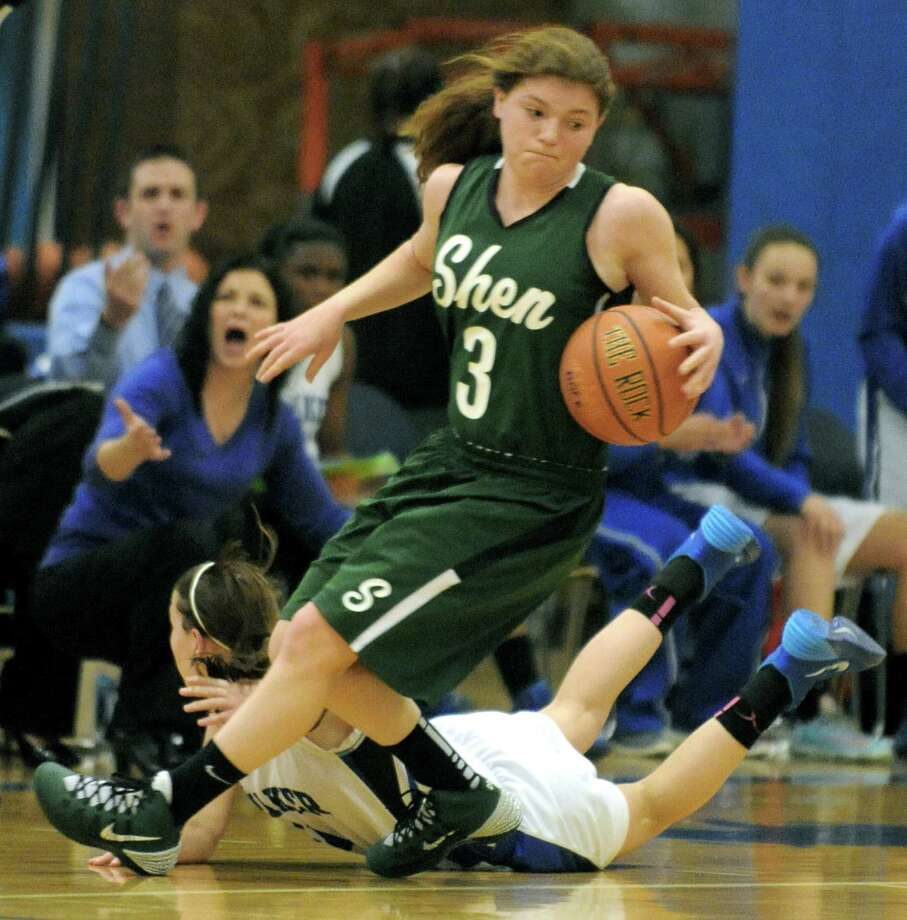 Shen's Maddy Shea and Shaker's Jenni Barra battle for a loose ball during their girl's high school basketball game on Tuesday Jan. 14, 2014 in Colonie, N.Y.  (Michael P. Farrell/Times Union) Photo: Michael P. Farrell / 00025340A