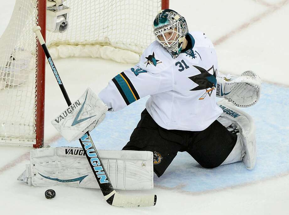 Sharks goalie Antti Niemi makes a save against the Capitals late in the third period, one of 35 he made in San Jose's 2-1 win. Photo: Chuck Myers, McClatchy-Tribune News Service