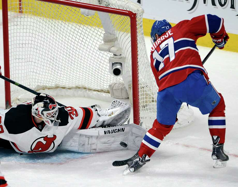 New Jersey Devils goalie Martin Brodeur (30) stops Montreal Canadiens left wing Rene Bourque (17) during second period National Hockey League action, Tuesday, Jan. 14, 2014, in Montreal. (AP Photo/The Canadian Press, Ryan Remiorz) ORG XMIT: RYR106 Photo: Ryan Remiorz / The Canadian Press