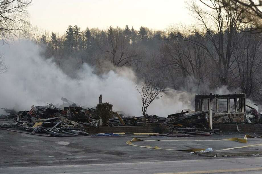 Hot spots are still evident at the site of Tuesday night's fire at the Villa Valenti in North Greenbush. (Skip Dickstein / Times Union)