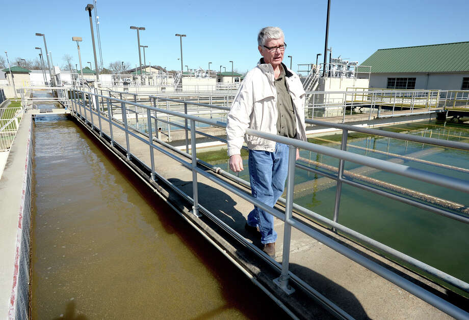 Barry Miller talks about the water purification process at the Beaumont water plant on Pine Street Tuesday. Outdoor standing ponds are the first stages of cleaning water. Photo taken Tuesday, January 14, 2014 Guiseppe Barranco/@spotnewsshooter Photo: Guiseppe Barranco, Photo Editor