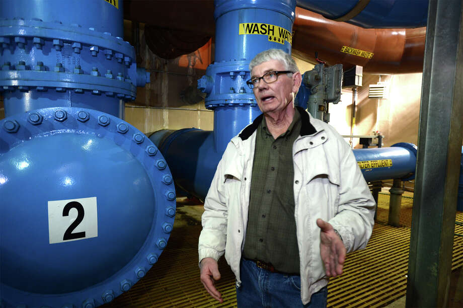 Barry Miller talks about the water purification process at the Beaumont water plant on Pine Street Tuesday. 