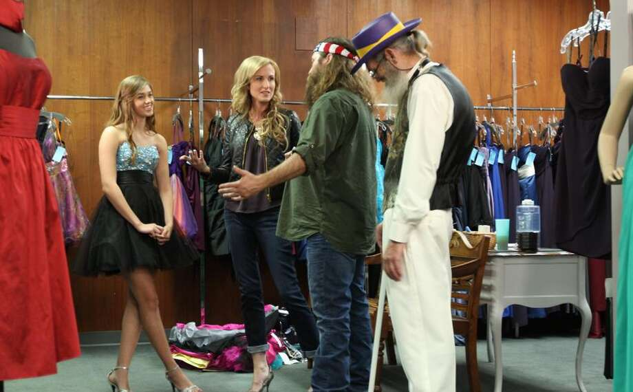 """Duck Dynasty"" dad Willie Robertson (third from left), and wife Korie (second from left) take teen daughter Sadie (left) dress shopping in ""Duck Be a Lady."" A dapper Uncle Si listens in. (Ducky Dynasty/A&E Television) Photo: AE Television"