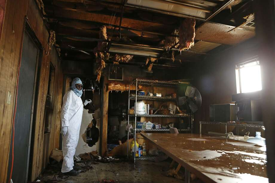 Deacon Felix Gibson, on Tuesday Jan. 14, 2014, looks through the burned and water damaged items inside the classrooms building at the Greater St. John Baptist Church, which was destroyed by a suspected arsonist in San Jose, Calif. Photo: Michael Macor, The Chronicle