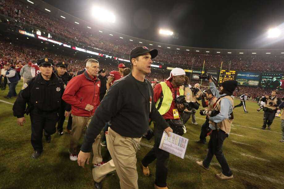 San Francisco 49ers'  head coach Jim Harbaugh leaves the field after the 49ers defeated the Atlanta Falcons on Monday, Dec. 23, 2013 at Candlestick Park in San Francisco, Calif. Photo: John Storey, For The Chronicle