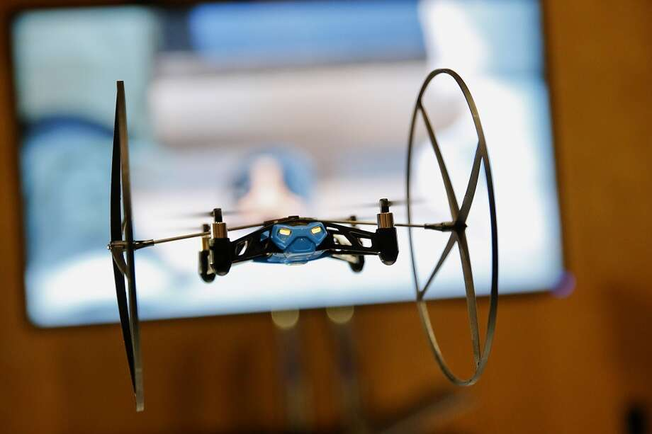 A Parrott Mini Drone hovers during the CES Unveiled press event prior to the 2014 Consumer Electronics Show in Las Vegas, Nevada, U.S., on Sunday, Jan. 5, 2014. The CES trade show, which runs until Jan. 10, is the world's largest annual innovation event that offers an array of entrepreneur focused exhibits, events, and conference sessions for technology entrepreneurs. Photo: Patrick T. Fallon, Bloomberg