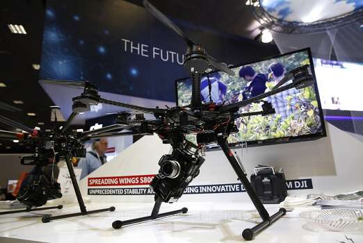 The DJI Spreading Wings S800 drone is displayed at the Dajiang Innovation Technology Inc. booth during the 2014 Consumer Electronics Show (CES) in Las Vegas, Nevada, U.S., on Thursday, Jan. 9, 2014. Photo: Patrick T. Fallon, Bloomberg