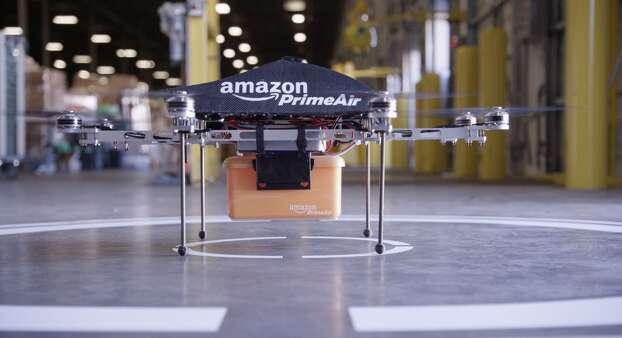 A remote aerial vehicle being called Prime Air that online retailer Amazon hopes to develop to deliver goods to customers. Amazon CEO Jeff Bezos hopes to deliver packages to customers in 30 minutes or less using the unmanned vehicles but says it could take years to advance the technology and get FAA approval. (Photo by Amazon via Getty Images) Photo: Amazon.com, Getty Images
