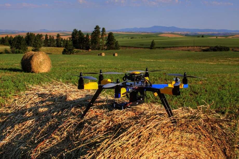 A multi-rotor hexacopter, an unmanned aircraft, is used to monitor a farm in Kendrick, Idaho. Experts say agriculture is the most promising commercial market for drones. The technology can be used for America's large-scale farms and vast rural areas where privacy and safety issues are less of a concern. Photo: Robert Blair, Associated Press