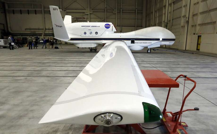 NASA's Global Hawk pilotless aircraft sits in a hangar after arriving from a science mission monitoring tropical storm Gabrielle, during a survey of unmanned aircraft and related systems developed by the NASA Dryden Flight Research Center at Edwards Air Force Base, Calif.  The Federal Aviation Administration announced Monday, Dec. 30, 2013, that six states will develop test sites for drones, a critical next step for the march of the unmanned aircraft into U.S. skies. Alaska, Nevada, New York, North Dakota, Texas and Virginia will host the research sites, the agency said. Photo: Reed Saxon, Associated Press