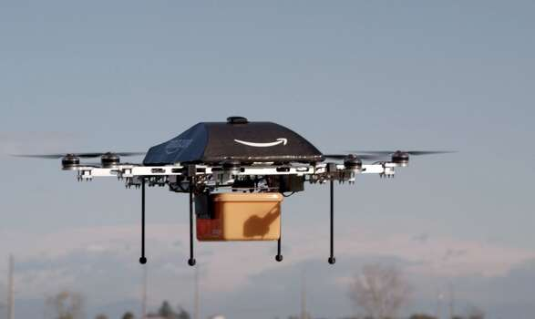 "Amazon shows a flying ""octocopter"" mini-drone that would be used to fly small packages to consumers. Amazon CEO Jeff Bezos revealed on December 1 that his company was looking to the future with plans to use mini-drones to deliver small packages. Photo: AMAZON, AFP/Getty Images"
