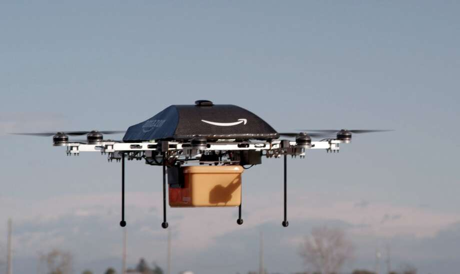 """Amazon shows a flying """"octocopter"""" mini-drone that would be used to fly small packages to consumers. Amazon CEO Jeff Bezos revealed on December 1 that his company was looking to the future with plans to use mini-drones to deliver small packages. Photo: AMAZON, AFP/Getty Images"""