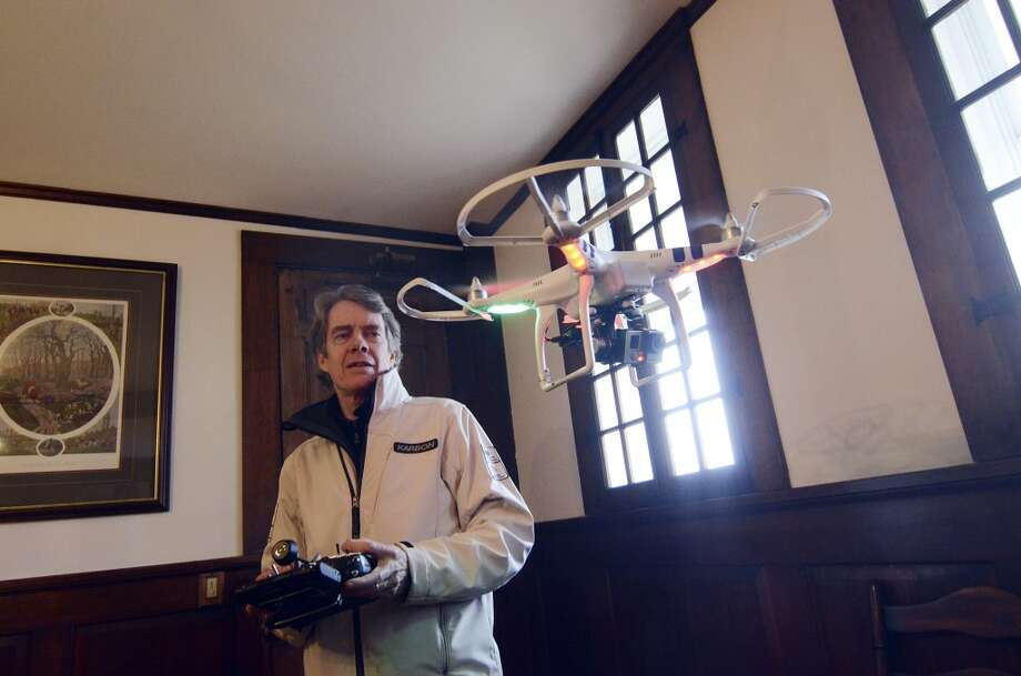 Terry Holland operates an  aerial drone camera system to make a video of the Berkshire Equestrian Center in Richmond, Mass.,  for Tucker Welch Properties, LLC, Monday, Jan. 13, 2014.  Holland says he planned to use the footage to create a two-minute video that those interested in the property could access online. Drones have been used to market luxury properties in other areas of the country. Photo: Ben Garver, Associated Press