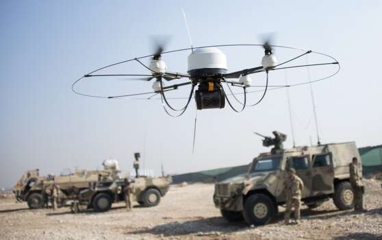 A Mikado drone of the Bundeswehr flies during a show of  German soldiers at Camp Marmal in Mazar-e-Sharif on December 23, 2013. Photo: JOHANNES EISELE, AFP/Getty Images