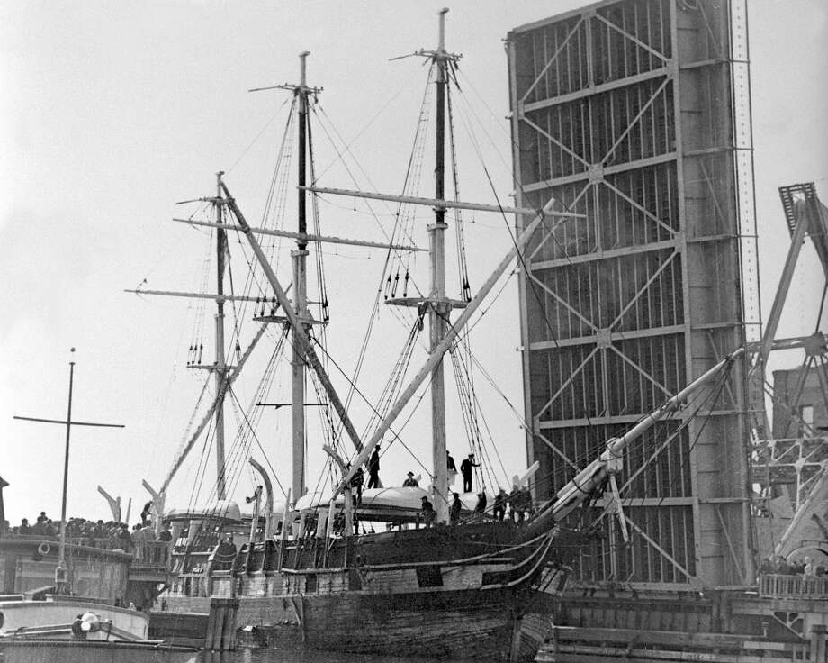In this Nov. 8, 1941 photo released by Mystic Seaport, the whaling ship Charles W. Morgan passes under the Mystic drawbridge in Mystic, Conn. The world''s last surviving wooden whaling ship is nearing completion of a $7 million restoration and will be launched on July 21, 2013, the 172nd anniversary of the vessel's original launch in New Bedford, Mass. (AP Photo/Mystic Seaport) Photo: Associated Press
