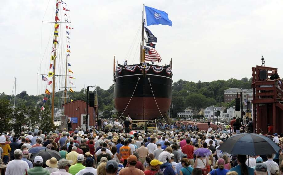 Filmmaker Ric Burns addresses the launching ceremony for the historic whaleship Charles W. Morgan into the waters of the Mystic River Sunday July 21, 2013 at the Mystic Seaport's H.B. duPont Preservation Shipyard in Stonington, Conn.. The launch takes place on the 172nd anniversary of the ship's original launch in 1841 in New Bedford, Massachusetts. The Morgan, the last remaining wooden whaling ship remaining and the oldest American commercial vessel still in existence as well as a National Historic Landmark, is slated to embark on its 38th voyage, a tour of historic New England ports, in the spring and summer of 2014.  (AP Photo/The Day, Sean D. Elliot) Photo: Sean D. Elliot, Associated Press
