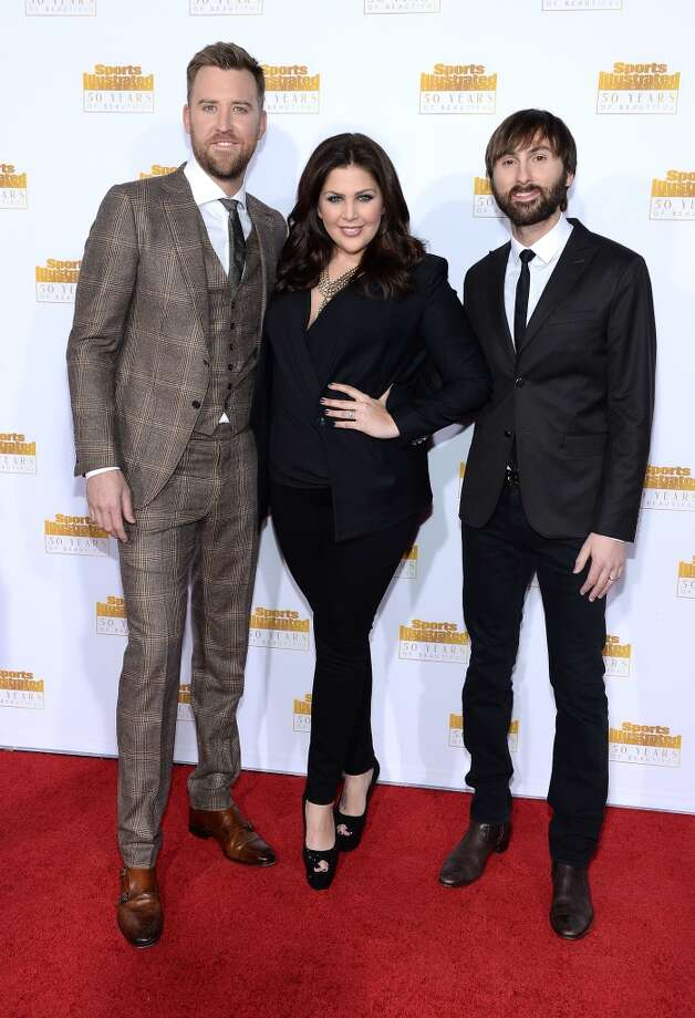 (L-R) Charles Kelley, Hillary Scott, and Dave Haywood of Lady Antebellum attend NBC and Time Inc. celebrate the 50th anniversary of the Sports Illustrated Swimsuit Issue at Dolby Theatre on January 14, 2014 in Hollywood, California. Photo: Dimitrios Kambouris, Getty Images