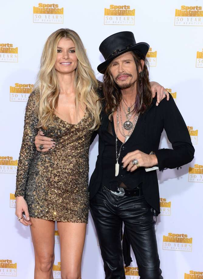 Model Marisa Miller (L) and musician Steven Tyler of Aerosmith attend NBC and Time Inc. celebrate the 50th anniversary of the Sports Illustrated Swimsuit Issue at Dolby Theatre on January 14, 2014 in Hollywood, California. Photo: Dimitrios Kambouris, Getty Images