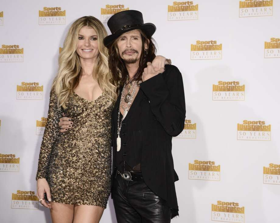 "Singer Steven Tyler, right, and model Marisa Miller arrive at the ""50 Years of Beautiful"" television event celebrating the Sports Illustrated Swimsuit Issue's 50th Anniversary at the Dolby Theatre on Tuesday, Jan. 14, 2014 in Los Angeles. Photo: Dan Steinberg, Associated Press"